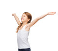 Smiling teenage girl with raised hands shirt design happiness freedom future concept in blank white shirt and closed eyes Royalty Free Stock Image