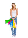 Smiling teenage girl with shopping bags Royalty Free Stock Photo