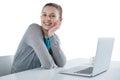 Smiling teenage girl sitting against white background Royalty Free Stock Photo