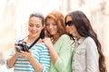 Smiling teenage girls with camera Royalty Free Stock Photo