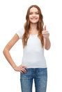 Smiling teenager in blank white t shirt design concept showing thumbs up Stock Photography