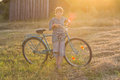 Smiling teenager boy standing with bicycle Royalty Free Stock Photo