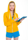 Smiling teenager girl working on tablet pc isolated white Stock Image