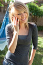Smiling Teenager on Mobile Phone Stock Images