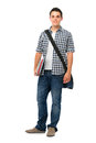 Smiling teenager with a schoolbag standing on white background Stock Images