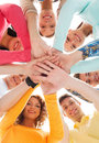 Smiling teenagers with hands on top of each other friendship youth and people concept group Stock Photography