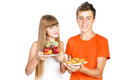 Smiling teenagers shows healthy lunch Stock Photos