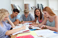 Smiling teenagers studying in the library Royalty Free Stock Photo