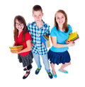 Smiling teens looking up while holding colorful books wide angle shot Stock Photography