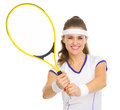Smiling tennis player showing racket isolated on white Royalty Free Stock Images