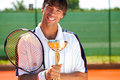 Smiling tennis winner happiness player with medal and goblet Royalty Free Stock Image