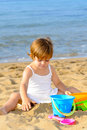 Smiling toddler girl playing her toys beach Royalty Free Stock Photo