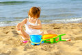 Smiling toddler girl playing her toys beach Royalty Free Stock Photography