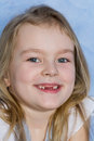 Smiling toothless girl with blond hair portrait of Royalty Free Stock Photography