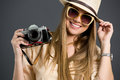 Smiling tourist girl with photo camera and sunglasses Royalty Free Stock Photo