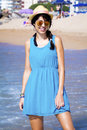 Smiling  tourist woman posing for photo on the beach Royalty Free Stock Photo