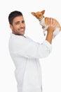 Smiling vet lifting up chihuahua Royalty Free Stock Photo