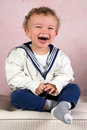Smiling vintage boy cute little victorian toddler dressed in sailor costume Royalty Free Stock Photos