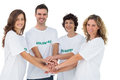 Smiling volunteer group piling up their hands on white background Stock Photo