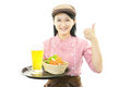 Smiling waitress carrying a meal Royalty Free Stock Photo