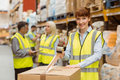 Smiling warehouse workers preparing a shipment Royalty Free Stock Photo