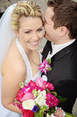 Smiling wedding couple laughing sharing happy private moment their wedding day Stock Images