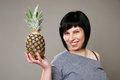 Smiling woman with ananas Royalty Free Stock Photography