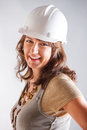 Smiling woman architect designer wearimh hardhat Royalty Free Stock Photos