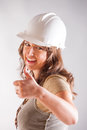 Smiling woman architect designer wearimh hardhat thumbs up Royalty Free Stock Image