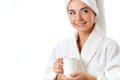 Smiling woman in bathrobe holding mug Royalty Free Stock Photography