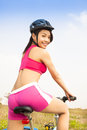 Smiling woman biker riding folding bicycle in outdoor Stock Images