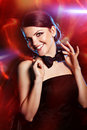 Smiling woman with black bow tie portrait of young beautiful girl wearing smoking Royalty Free Stock Photography