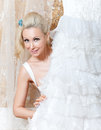 Smiling woman of the blonde with a white wedding dress girl in hands Royalty Free Stock Photos