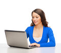 Smiling woman in blue clothes with laptop computer electronics and gadget concept Royalty Free Stock Photos