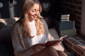 Smiling woman with a book