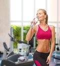 Smiling woman with bottle of water fitness healthcare and dieting concept sporty Royalty Free Stock Photography