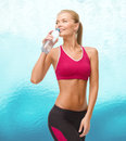 Smiling woman with bottle of water fitness healthcare and dieting concept sporty Stock Photography