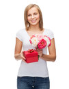 Smiling woman with bouquet of flowers and gift box holidays love concept young red Stock Image