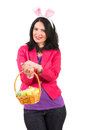 Smiling woman with bunny ears casual holding basket easter eggs isolated on white background Royalty Free Stock Images