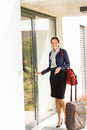 Smiling woman business flight attendant arriving home Stock Photography