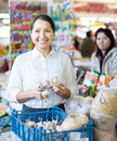 Smiling woman buys garlic for planting women on the market Royalty Free Stock Photos