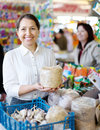 Smiling woman buys the seeds in bag mature women on market Stock Images