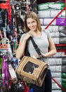 Smiling woman carrying pet bag in store portrait of mid adult Royalty Free Stock Photo
