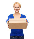 Smiling woman in casual clothes with parcel box post package and delivery concept Royalty Free Stock Photos