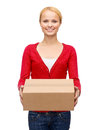 Smiling woman in casual clothes with parcel box Royalty Free Stock Photo