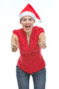 Smiling woman in Christmas hat showing thumb up Stock Photo