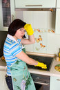 Smiling woman cleaning  cooker Royalty Free Stock Images