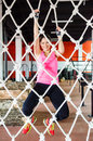 Smiling woman climbing on rope young net Royalty Free Stock Photos