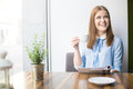 Smiling woman in coffee shop Royalty Free Stock Photo
