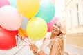 Smiling woman with colorful balloons Royalty Free Stock Photo